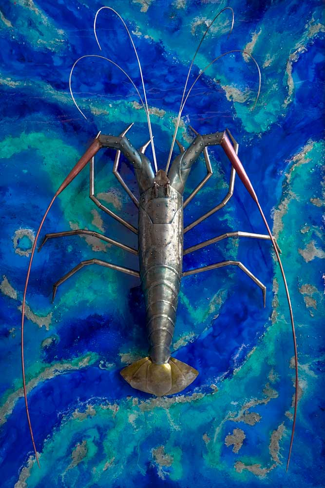 metal sculpture tropical cray on wall painting