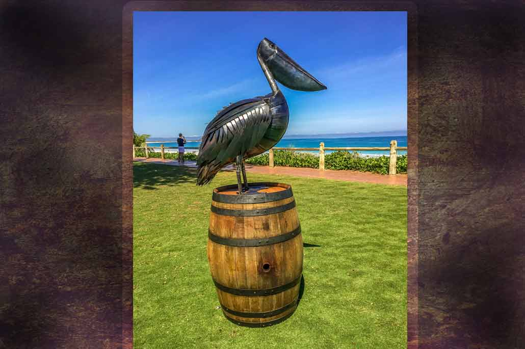 Art Pelican Metal Sculpture on a wine barrel